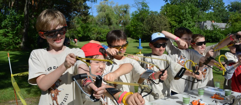 Slingshots! One of the many opportunities for fun, learning, and adventure at Twilight camp!